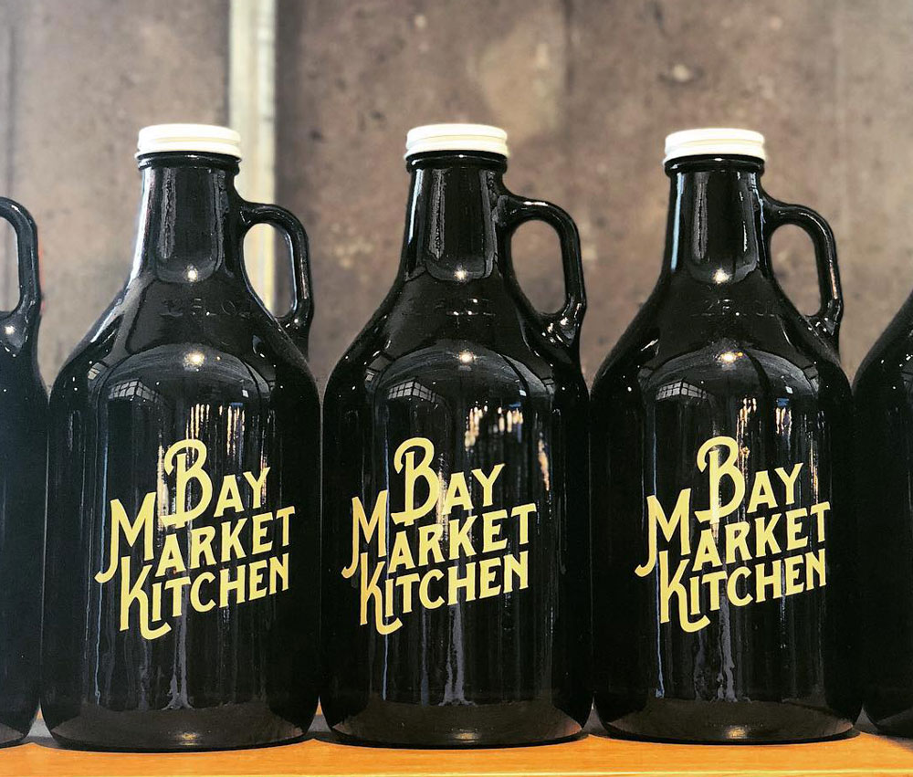 Image of three beer growlers with the Bay Market Kitchen logo