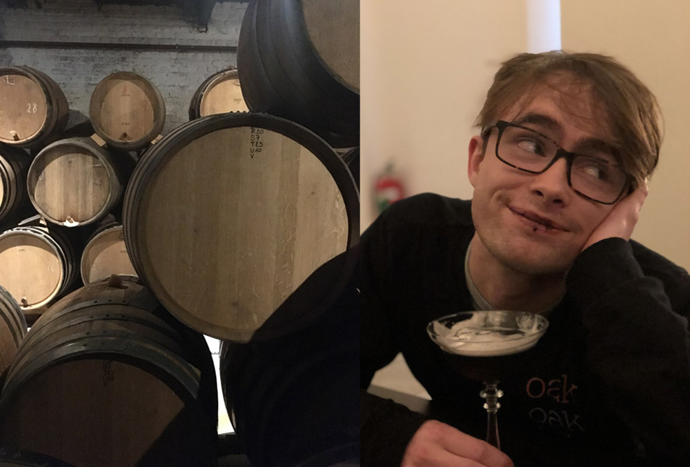 Daniel surrounded by barrels of beer